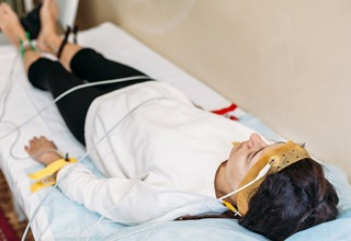 Man sleeping soundly with vitals monitor on hand