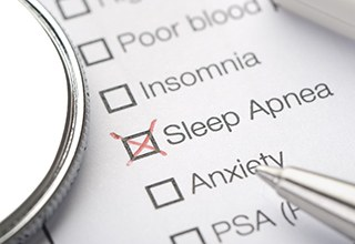 Checklist with red X on sleep apnea